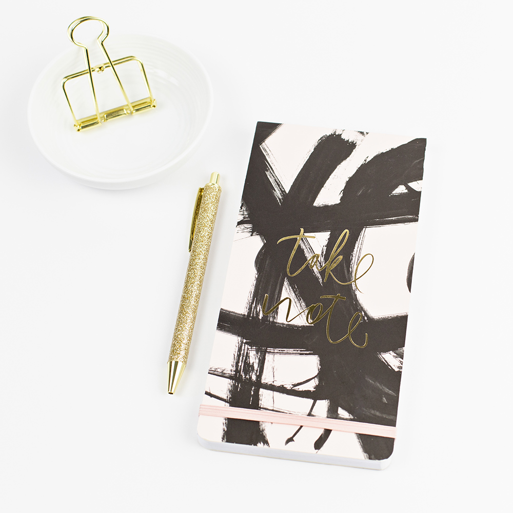 Notebook with pen and paper clip.